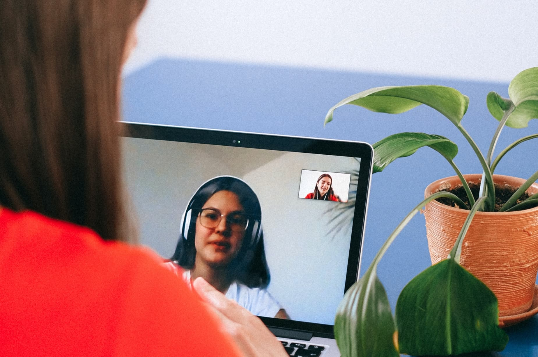 Two women on a video call on their laptops getting to know each other